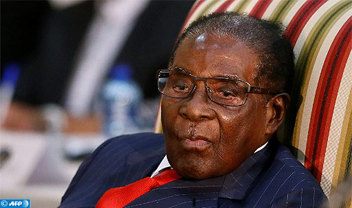 Zimbabwean President Robert Mugabe looks on as he attends the 2nd Session of the South Africa-Zimbabwe binational Commission (BNC) on October 3, 2017 at Sefako Makgatho Presidential Guest House in Pretoria.  / AFP PHOTO / Phill Magakoe