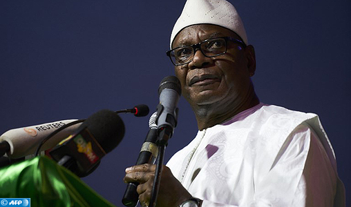 (FILES) In this file photo taken on August 10, 2018 Mali's incumbent president Ibrahim Boubacar Keita addresses his supporters during his last political rally in Bamako ahead of the runoff vote in Mali's presidential election on August 12, 2018. Keita was re-elected as Mali's president with 67% of the vote on August 16, 2018, according to Malian ministerial sources  following the second round of voting which saw President Ibrahim Boubacar Keita, 73, face off against former finance minister Soumaila Cisse, 68, in a reprise of the elections in 2013 that saw Keita win by a landslide. / AFP PHOTO / Michele CATTANI